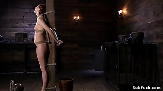 Hairy brunette slave gets stick on heels